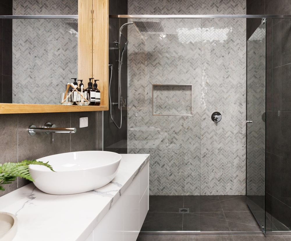 Big bathroom design tip: smaller feature tile to make the shower stand out